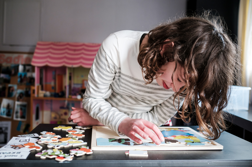 Child with autism solving a puzzle